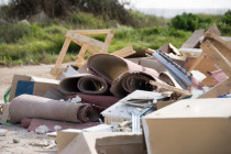 Fly tipping waste in field